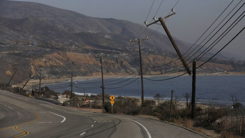 SANTA MONINCA MOUNTAINS, CA NOVEMBER 11, 2018: Broken electrical polls on PCH following the Woolse