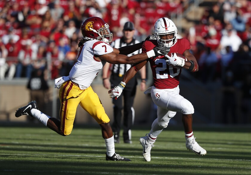 Stanford running back Bryce Love rushes against USC safety Marvell Tell III in September.