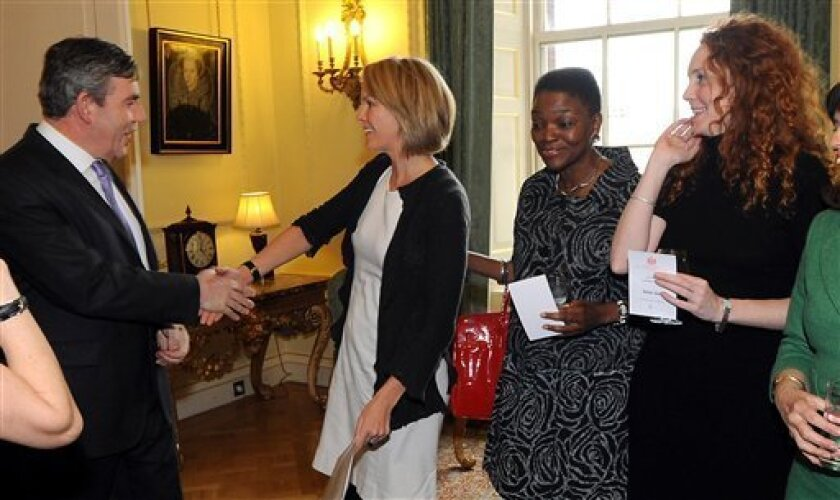 FILE - This is a March 8, 2008 file photo of former British Prime Minister Prime Minister Gordon Brown, Elisabeth Murdoch, daughter of media magnate Rupert Murdoch, 2nd left, politician Baroness Amos, 2nd right, and chief executive of News International Rebekah Brooks during a reception for women in business at 10 Downing Street in London. The scandal engulfing Rupert Murdoch's media empire exploded in several directions Monday July 11, 2011, with fresh reports of phone hacking attacks against some of the nation's most powerful figures, including royals and former Prime Minister Gordon Brown. (AP Photo/ Fiona Hanson/PA, File) UNITED KINGDOM OUT NO SALES NO ARCHIVE
