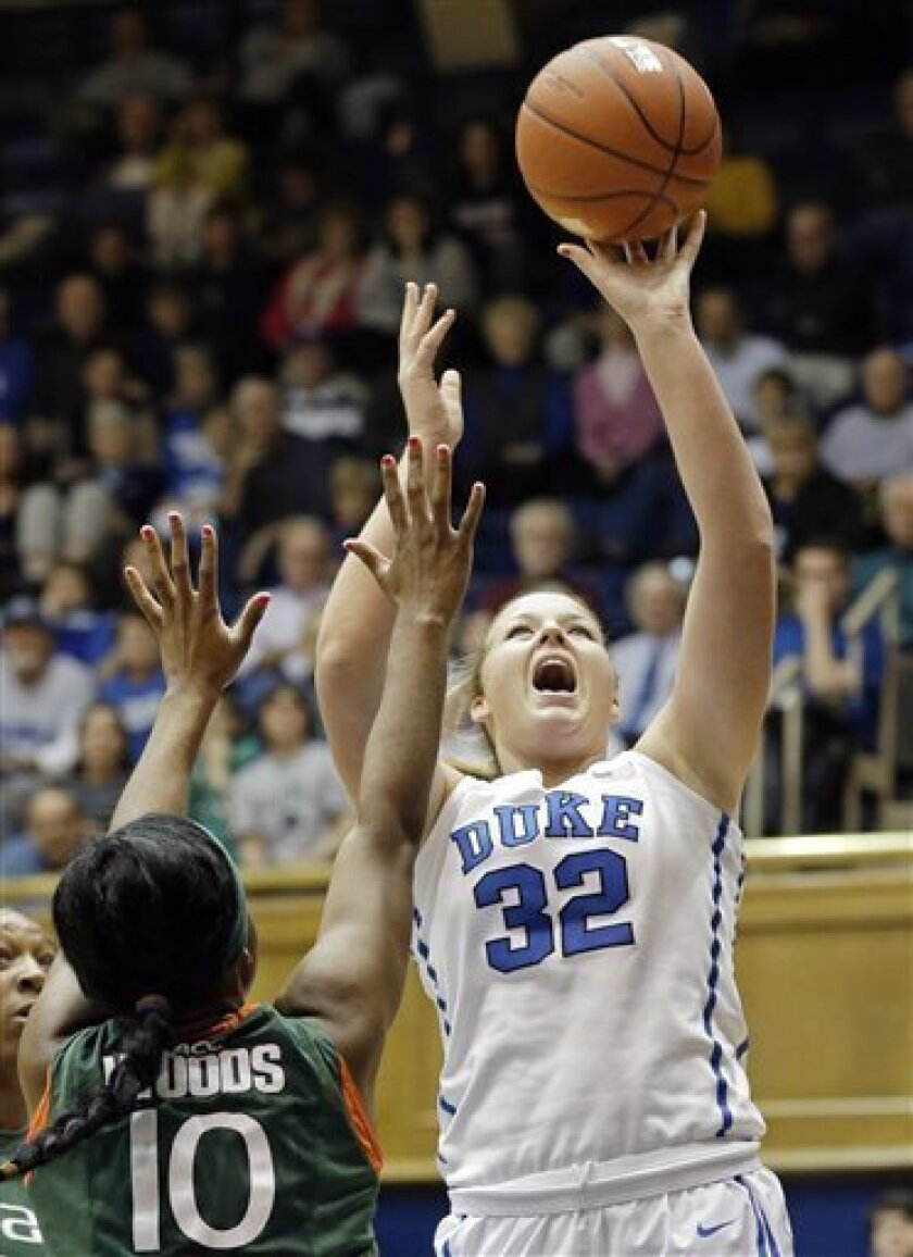 Duke's Tricia Liston (32) shoots over Miami's Michelle Woods (10) during the first half of an NCAA college basketball game in Durham, N.C., Thursday, Jan. 31, 2013. (AP Photo/Gerry Broome)