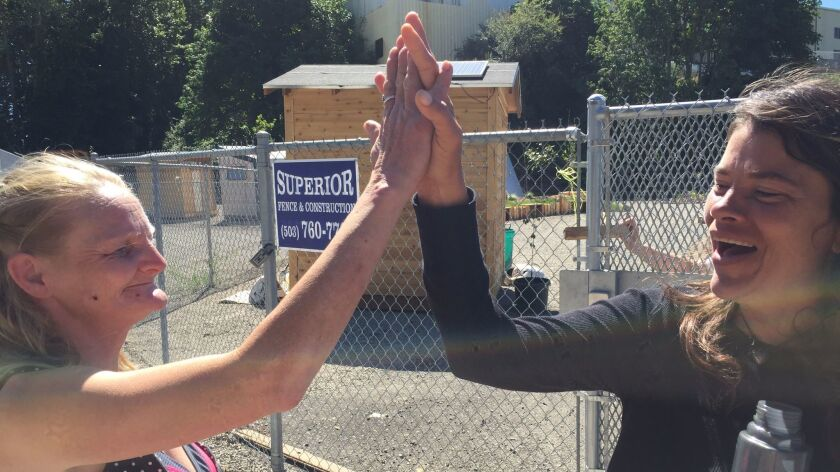 Village residents April Langworthy and Lynette Ingalls celebrate Ingalls' three months of sobriety.