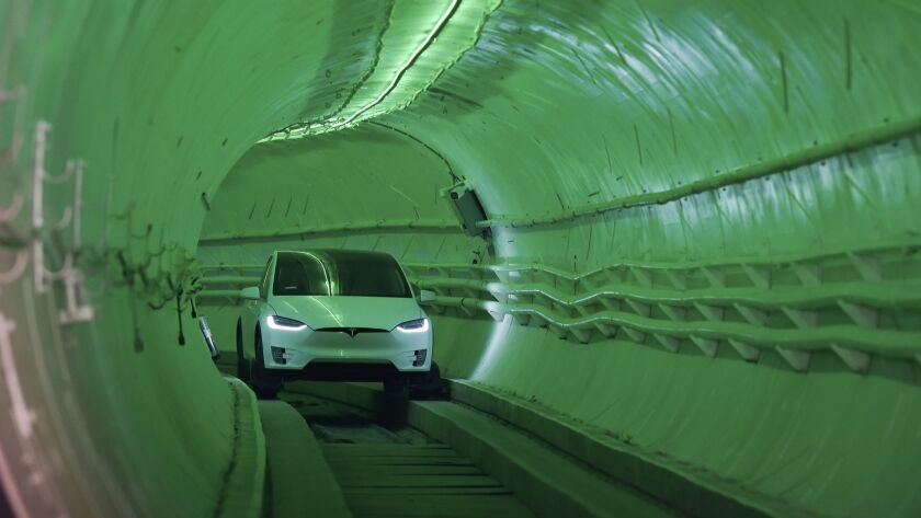 At an unveiling Tuesday in Hawthorne for Boring Co.'s first tunnel, Elon Musk arrived in a modified Tesla Model X that steered along the bumpy subterranean track using guide wheels.