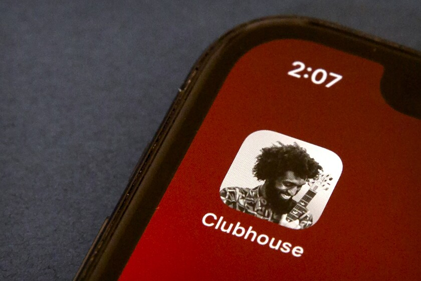 FILE - In this Feb. 9, 2021 file photo, the icon for the social media app Clubhouse is seen on a smartphone screen in Beijing. Oman has severed access to the buzzy new audio chat app Clubhouse, the country's telecommunications regulator confirmed Monday, setting off fears that authorities across the Persian Gulf may censor a rare open forum for discussion of sensitive topics in the region. (AP Photo/Mark Schiefelbein, File)