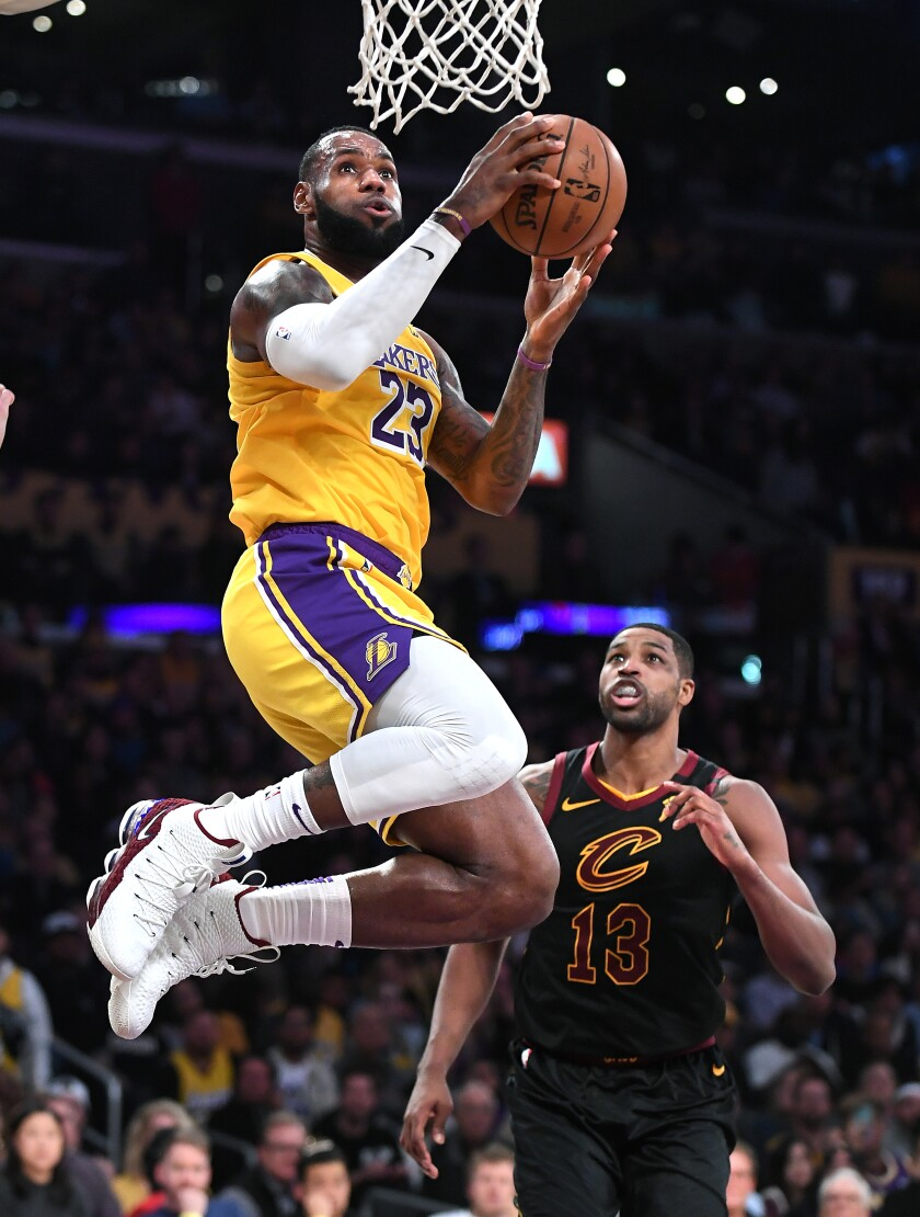 Lakers' LeBron James beats Cleveland Cavaliers' Tristan Thompson to score a basket in the fourth quarter at the Staples Center on Monday.