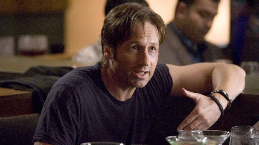 Actor David Duchovny says he might have taken up music decades earlier, if not for a bad guitar teacher.