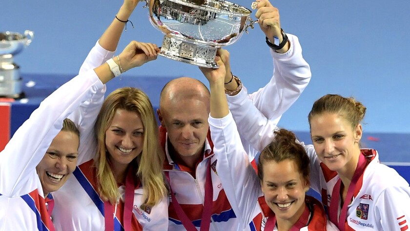 Czech Republic players and captain -- from left, Lucie Hradecka, Petra Kvitova, Petr Pala, Barbora Strycova and Karolina Pliskova -- celebrate after winning the Fed Cup on Sunday.