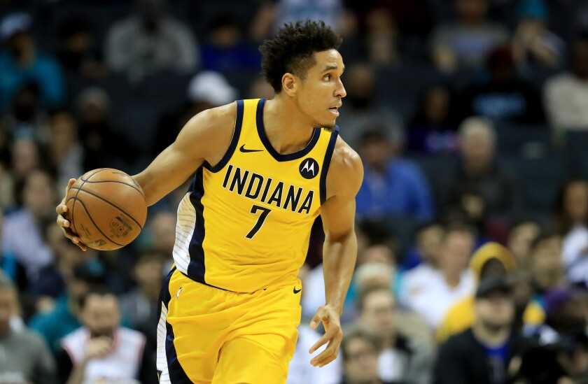 Pacers guard Malcolm Brogdon brings the ball upcourt during a game against the Hornets earlier this season.