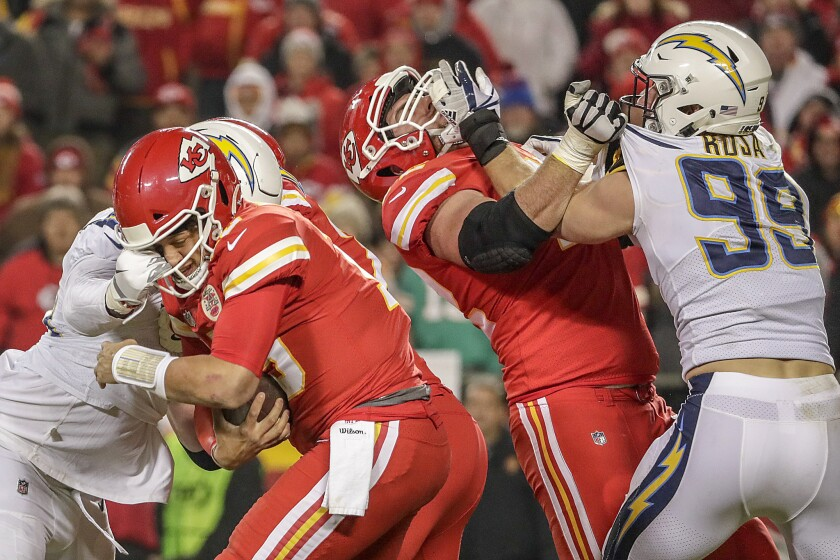 Chargers linebacker Melvin Ingram sacks Chiefs quarterback Patrick Mahomes during a game in 2018.