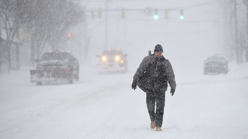 Central New York endures a snow storm with arctic like temperatures and wind in Syracuse Sunday, Jan
