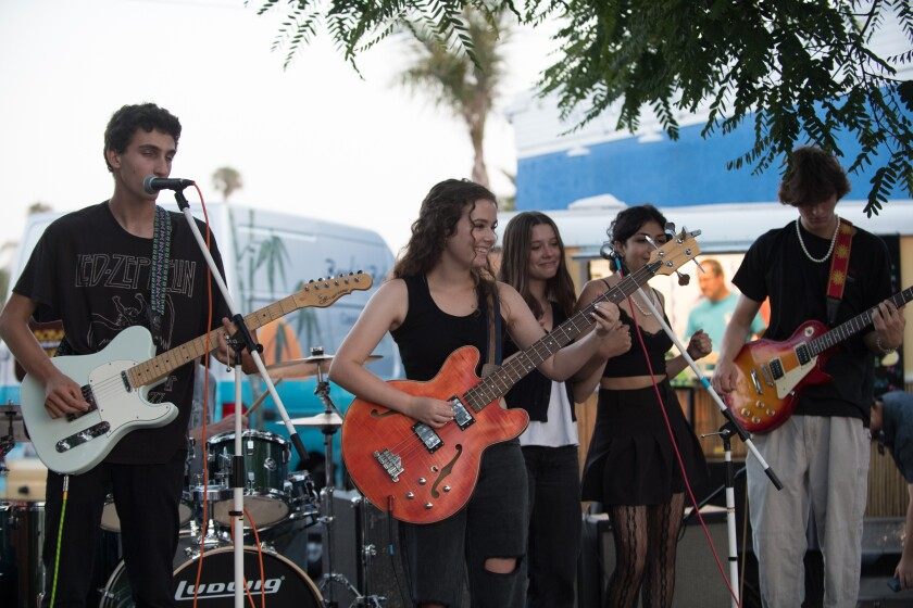 Kiara Blacher performing with the band Vixi at the July 10 benefit concert.