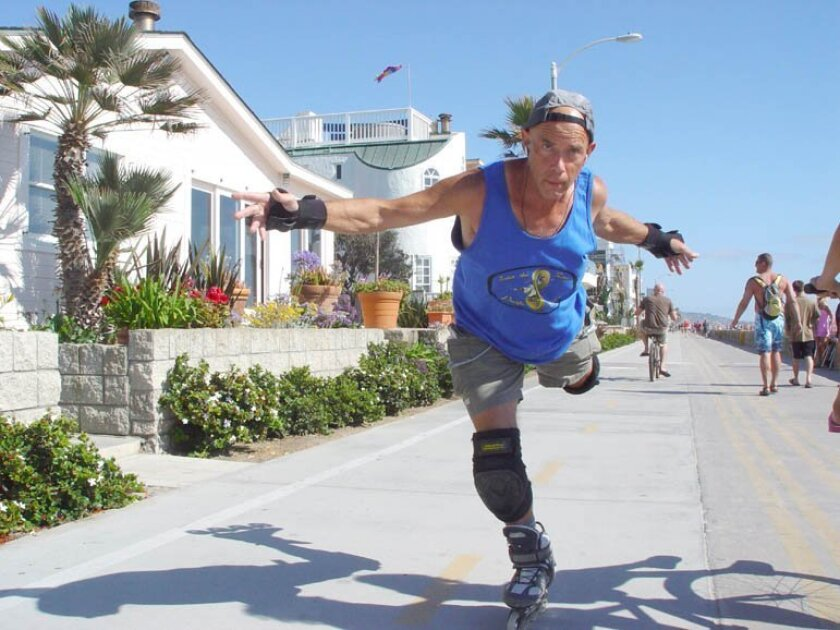 Dr. John Kitchin, or Slomo, skates Oceanfront Walk.