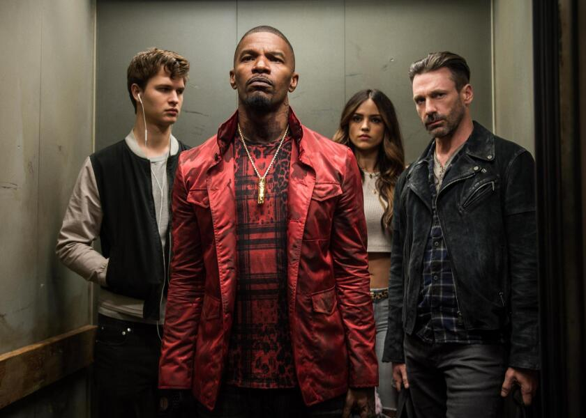 "Baby (Ansel Elgort, left), Bats (Jamie Foxx), Darling (Eiza González) and Buddy (Jon Hamm) decide on doing the heist in TriStar Pictures' ""Baby Driver."""