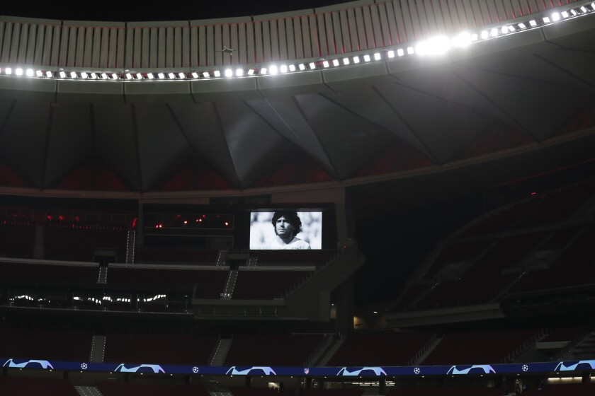 A picture of soccer legend Diego Armando Maradona is seen on the screen of the Wanda Metropolitano stadium in Madrid, Spain, prior to the Champions League group A soccer match between Atletico Madrid and Lokomotiv Moscow at Wednesday, Nov. 25, 2020. Maradona died Wednesday at the age of 60. (AP Photo/Manu Fernandez)
