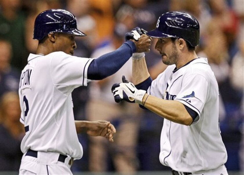 Tampa Bay Rays' Matt Joyce, right, is congratulated by teammate B.J. Upton after his two-run home run in the seventh inning of a baseball game Tuesday, May 31, 2011, in St. Petersburg, Fla. (AP Photo/Mike Carlson)