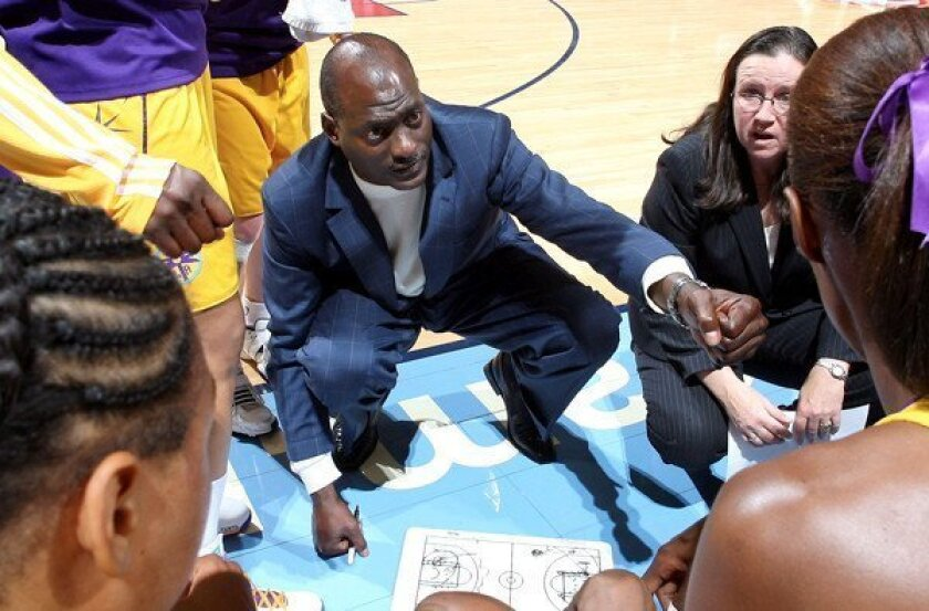 Michael Cooper gives final instructions to the Sparks before a game against the Atlanta Dream.