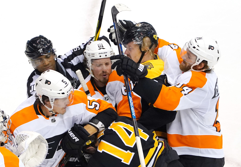 Members of the Boston Bruins and Philadelphia Flyers scuffle