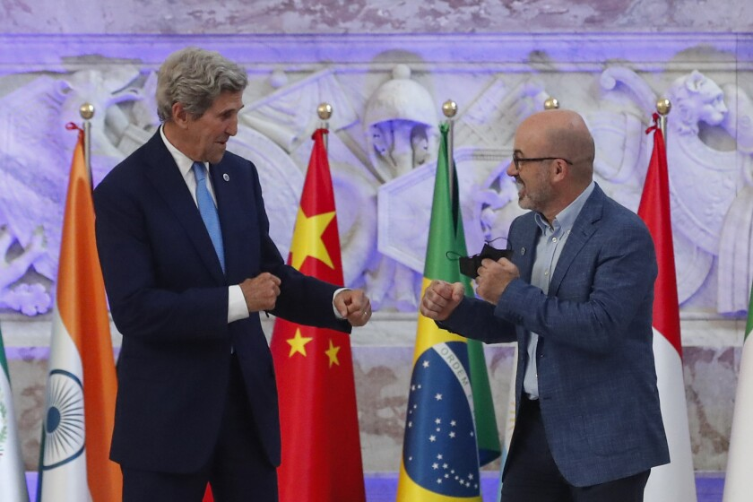 Special Presidential Envoy for Climate John Kerry and Italian Minister for Ecological Transition Roberto Cingolani pose during a photo opportunity at Palazzo Reale in Naples, Italy, Friday, July 23, 2021, where a G20 meeting on environment, climate and energy is under way. (AP Photo/Salvatore Laporta)