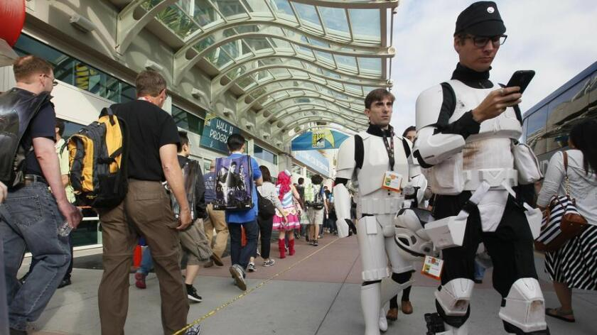 So it begins! early arrivals at the convention center on the opening day of Comic-Con International 2015. . (John Gibbins)