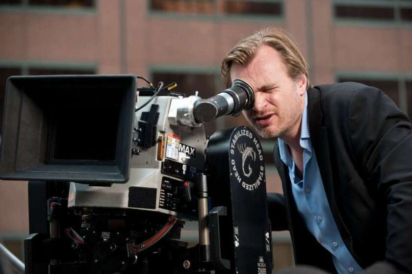 """Christopher Nolan sets up a shot on the set of """"The Dark Knight Rises."""""""