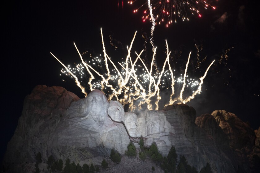 FILE - In this July 3, 2020, file photo, fireworks light the sky over the Mount Rushmore National Memorial near Keystone, S.D. A federal judge on Wednesday, June 2, 2021 rebuffed South Dakota Gov. Kristi Noem's efforts to force the National Park Service to grant the state permission to shoot fireworks from Mount Rushmore National Memorial to celebrate Independence Day this year. (AP Photo/Alex Brandon File)