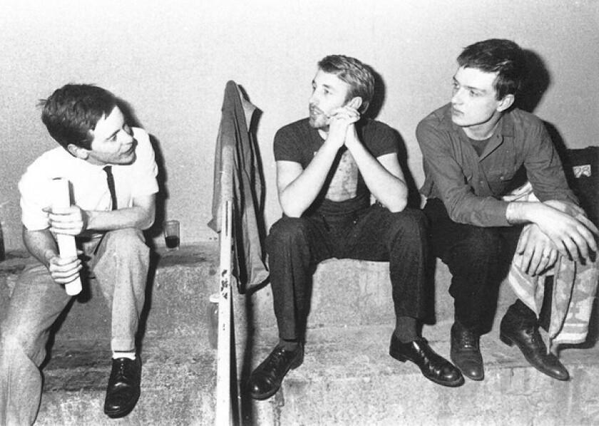 Peter Hook, center, with Joy Division bandmates Bernard Sumner, left, and Ian Curtis.