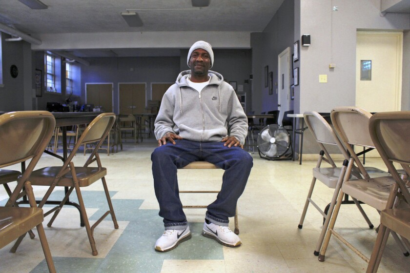 """In this Dec. 11, 2019, photo, Quentin Blackburn poses for a photo in Milwaukee. Blackburn is a felon who didn't realize he could vote when his probation was finished. """"When I became a felon, it was like something was stripped from me,"""" he said. """"I felt like I didn't matter, you know, in a sense. So now I can vote now. It's good news. I'm happy."""" (AP Photo/Carrie Antlfinger)"""