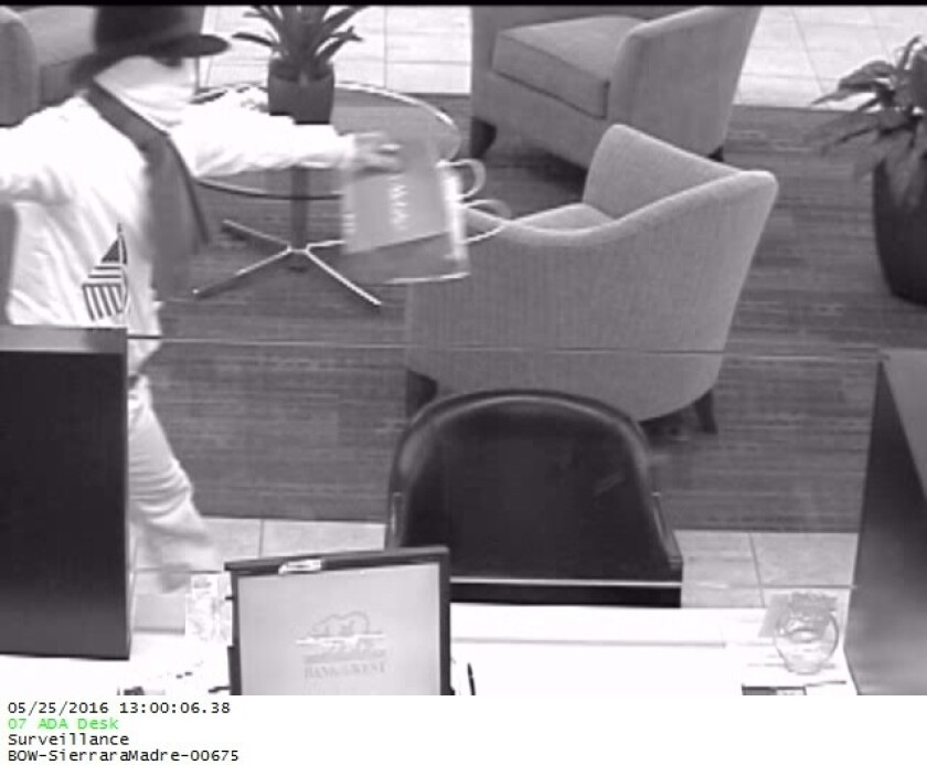 Bank robber enters the branch.