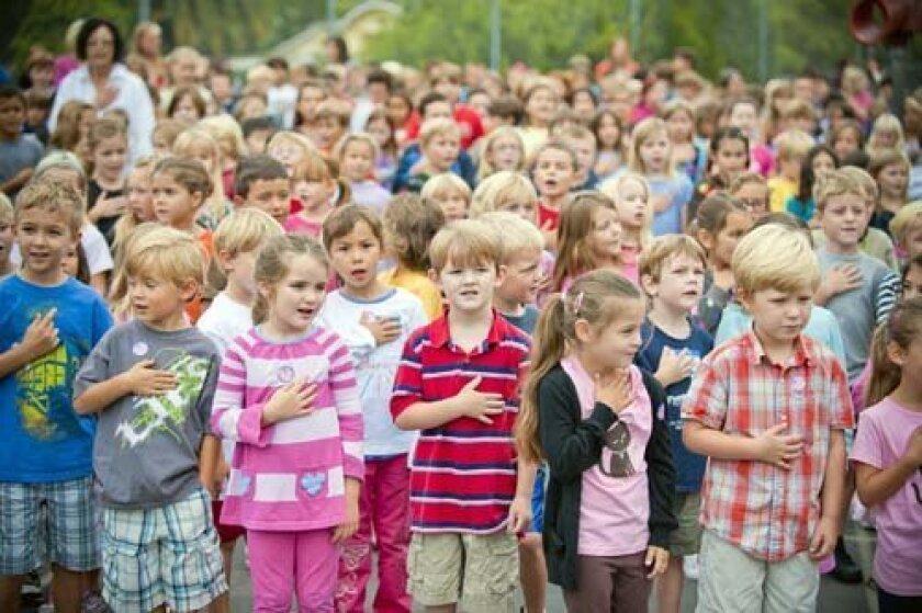 La Jolla Elementary School students say the Pledge of Allegiance. Photo: Stephen Simpson