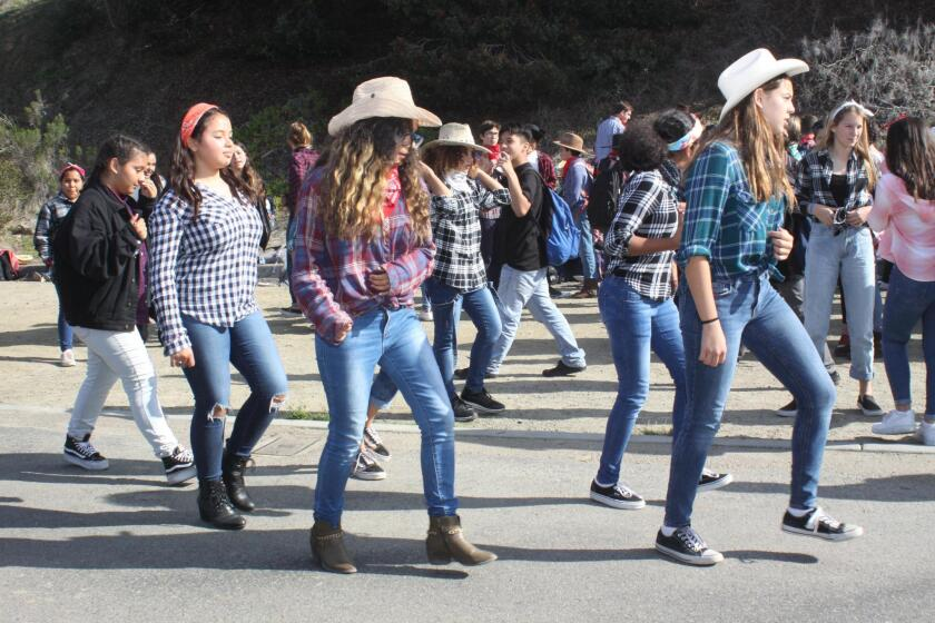 Students dance to the Spanish version of 'Achy Breaky Heart' during Muirlands Middle School's Western BBQ on Dec. 20, 2018.