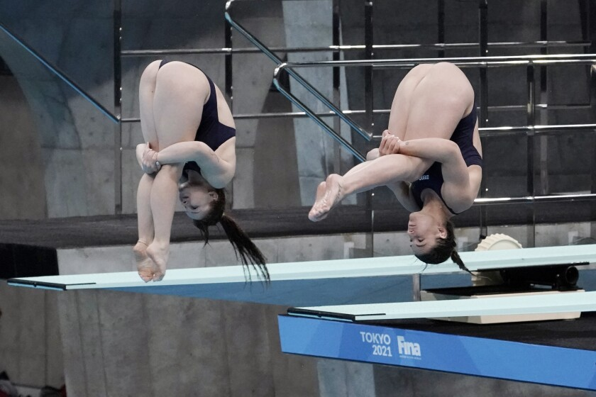 Elena Bertocchi and Chiara Pellacani of Italy perform a dive during the women's synchronized 3-meter springboard finals at the FINA Diving World Cup Saturday, May 1, 2021, at the Tokyo Aquatics Centre in Tokyo. Bertocchi and Pellacani won the Bronze medal in the category. (AP Photo/Eugene Hoshiko)