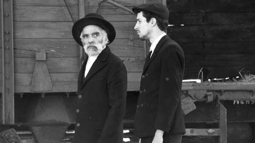 (L-R) - Hermann Samuel (Ivan Angelus) and his son (Marcell Nagy) arrive via train to a small village