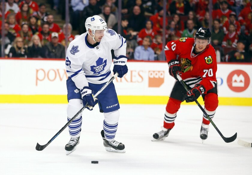Toronto Maple Leafs right wing Brad Boyes (28) looks to shoot the puck as Chicago Blackhawks left wing Dennis Rasmussen (70) defends during the first period of an NHL hockey game on Monday, Feb. 15, 2016, in Chicago. (AP Photo/Jeff Haynes)