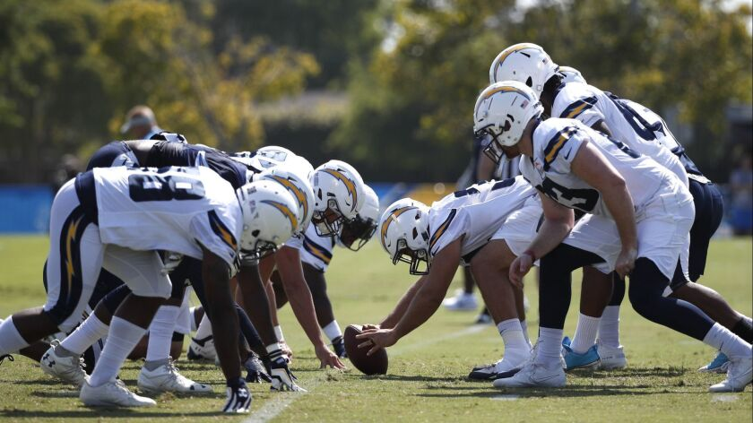 Los Angeles Chargers players run a drill during NFL football practice, Sunday, July 29, 2018, in Cos