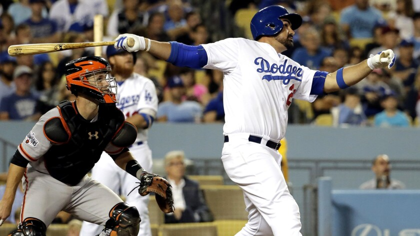 Dodgers first baseman Adrian Gonzalez, watching his two-run home run in the sixth inning, ultimately delivered the game-winning hit against the Giants in the 14th inning Monday night.
