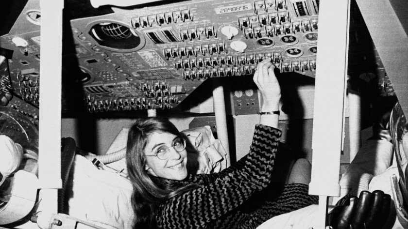Margaret Hamilton, mathematic and computer programmer at the MIT Instrumentation Laboratory, sits in a mockup of the Apollo command module.