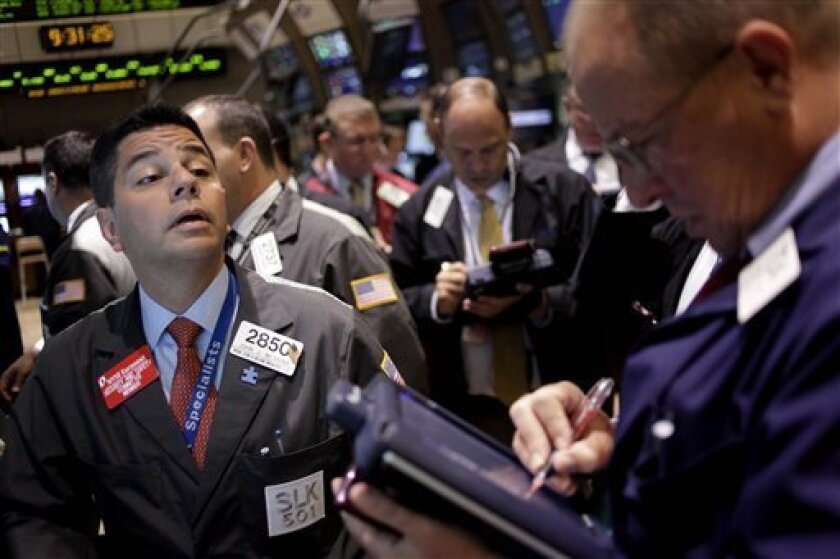 In this June 2, 2011 photo, traders work on the floor at the New York Stock Exchange in New York. Stock markets were trading in a fairly volatile manner Friday, June 3, as investors awaited U.S. jobs data and the latest appraisal of Greece's economy. (AP Photo/Seth Wenig)