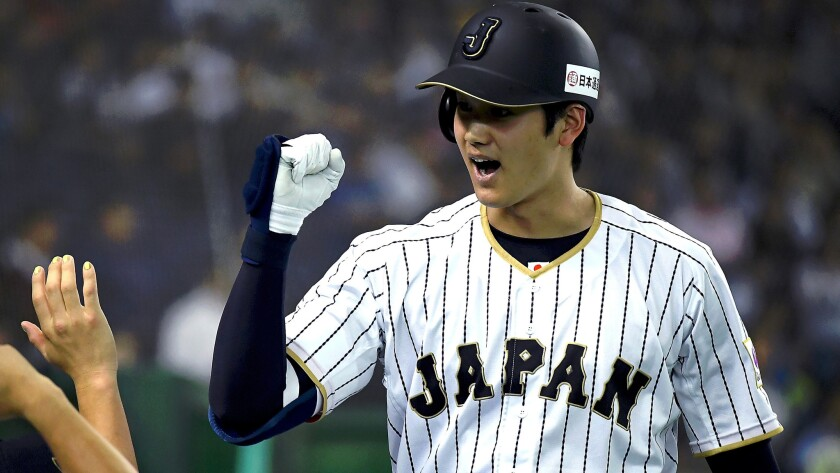 Shohei Ohtani celebrates after hitting a solo homer against the Netherlands during an exhibition game in 2016.