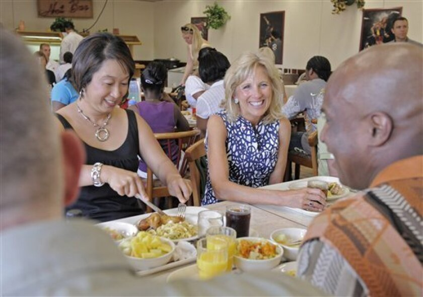 Jill Biden, wife of Vice President Joe Biden, center, talks with Sergeant Eric Gholston, right, and his wife Army Gholston, left, inside a dining facility at Warner Barracks, a U.S. Army Garrison in Bamberg, southern Germany, on Friday, July 3, 2009. Jill Biden visits U.S. Army Garrisons in Bamberg and Schweinfurt on July 3rd and July 4th to celebrate the Independence Day with soldiers and their family members stationed in Germany. This is part of Biden's ongoing work to raise awareness and show appreciation for members of the military and their families. (AP Photo/Jens Meyer)