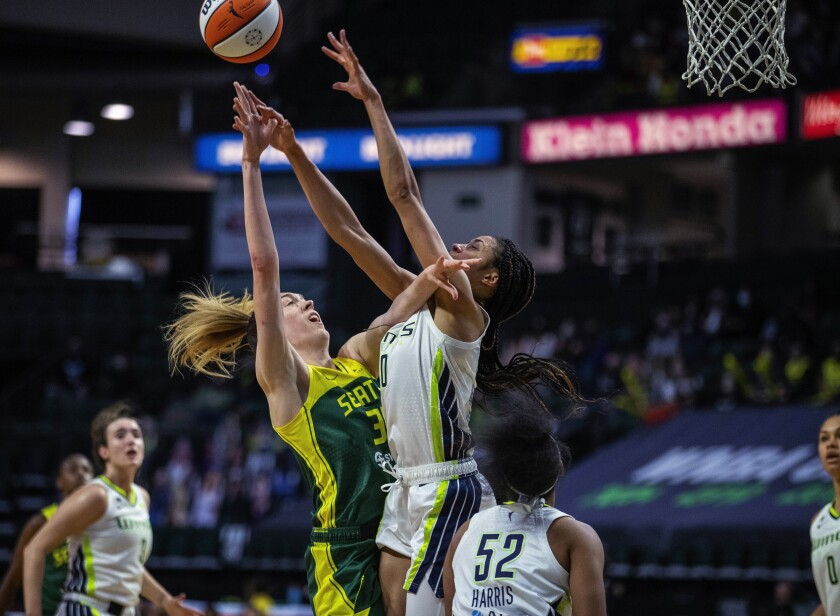 Seattle Storm's Breanna Stewart shoots as Dallas Wings forward Isabelle Harrison defends during a WNBA basketball game Friday, June 4, 2021, in Everett, Wash. (Dean Rutz/The Seattle Times via AP)