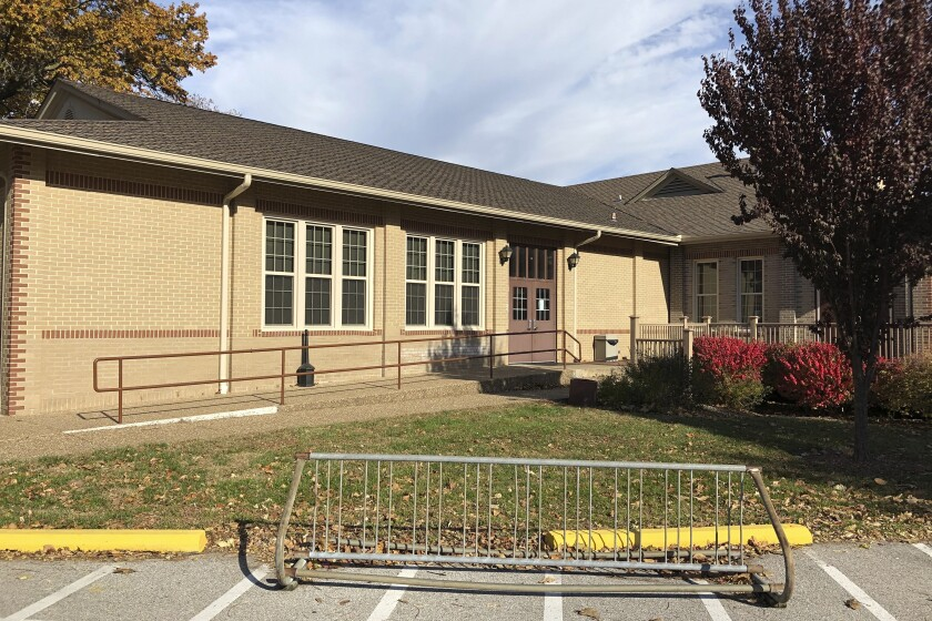 The Blanchette Park Memorial Hall is seen Nov. 5, 2020, in St. Charles, Missouri. A Missouri Poll worker who worked Tuesday at this site had tested positive for COVID-19 Oct. 30 but ignored advice to quarantine and worked anyway. St. Charles County officials say that worker later died. St. Charles County, Missouri, spokeswoman Mary Enger said in a news release Thursday that the person whose cause of death is not yet known was an election judge supervisor. (AP Photo by Jim Salter)