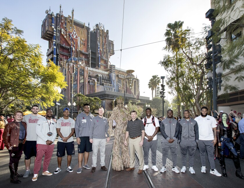 ROSE BOWL TEAMS VISIT DISNEYLAND RESORT (December 27, 2017) Ð No. 2 Oklahoma Sooners and No. 3 Georgia Bulldogs made their first official appearances of the Rose Bowl Game week on Wednesday, Dec. 27, 2017, with a special ceremony at Disney California Adventure Park in Anaheim, Calif. Players and coaches from both teams are pictured with Groot, Gamora and Star-Lord at the Guardians of the Galaxy Ð Mission: BREAKOUT! attraction. The teams will play in the 104th Rose Bowl game on Monday, January 1, 2018.