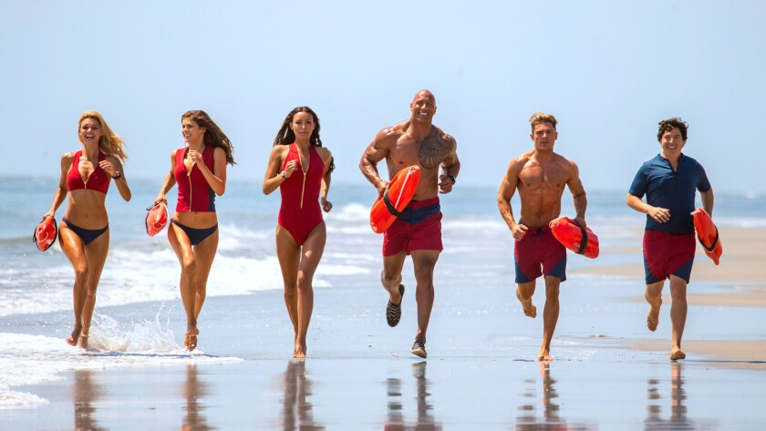 "Ready for their slo-mo shot: From left, Kelly Rohrbach, Alexandra Daddario, Ilfenesh Hadera, Dwayne Johnson, Zac Efron and Jon Bass in the new film ""Baywatch."""
