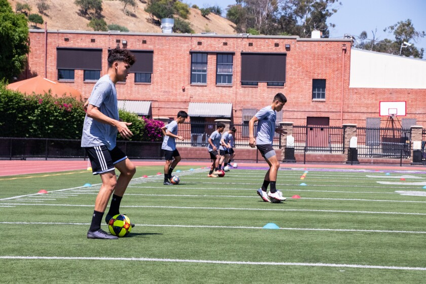 L.A. Cathedral soccer players work out in July under social distancing measures.