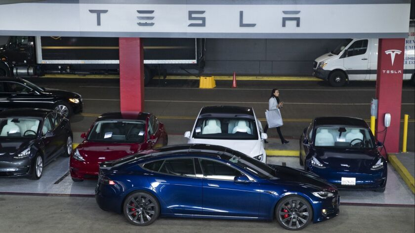 Tesla vehicles for sale in the parking garage of the Westfield Topanga shopping center in Canoga Park.