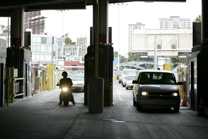 The number of people crossing the border at the San Ysidro Port of Entry -- seen here in 2009 -- has dipped sharply in during the past decade, due to a combination of factors that include tighter security measures.