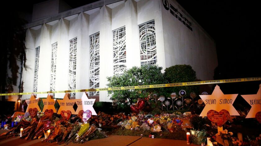 The Star of David memorials are lined with flowers at the Tree of Life synagogue two days after a mass shooting in Pittsburgh, Pennsylvania on October 29.