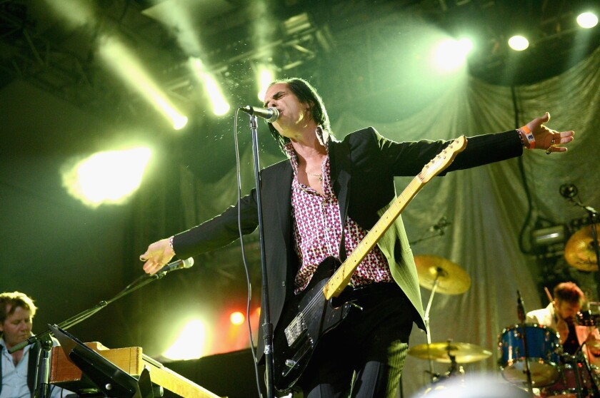 Nick Cave and Grinderman perform at the Coachella Music and Arts Festival on Friday.