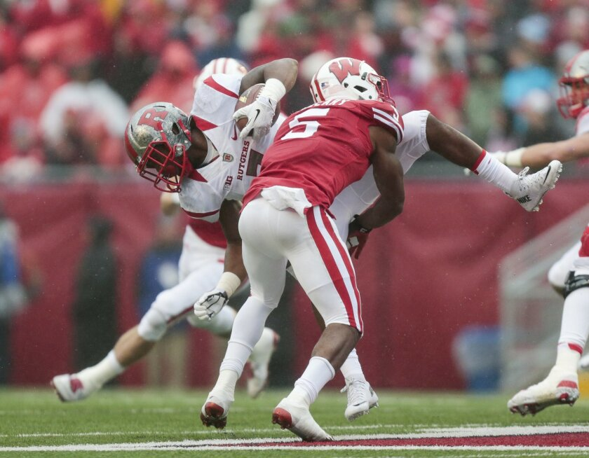 Wisconsin cornerback Darius Hillary (5) up ends Rutgers running back Robert Martin (7) during the first half of an NCAA college football game Saturday, Oct. 31, 2015, in Madison, Wis. (AP Photo/Andy Manis)