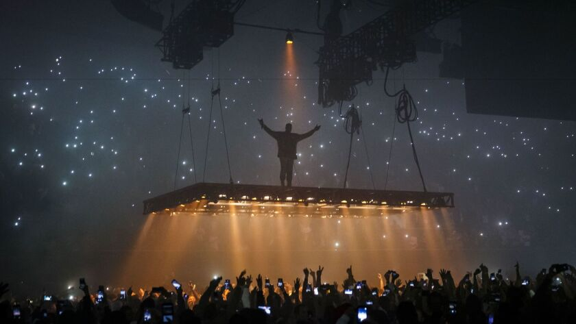 Kanye West hovers above the crowd at the Forum on Oct. 25.