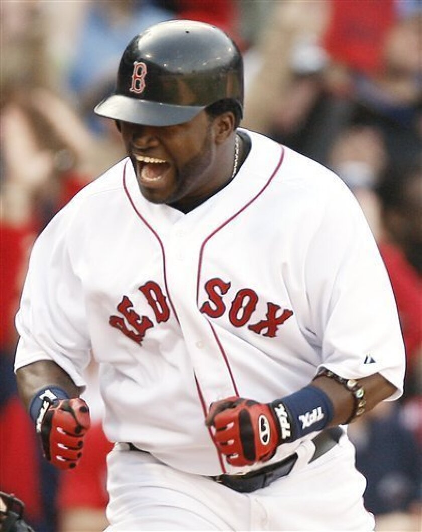 Boston Red Sox's David Ortiz yells after scoring the game-tying run on a triple by teammate Dustin Pedroia during the eighth inning of the Red Sox's 6-5 win over the Texas Rangers in a baseball game at Fenway Park in Boston, Sunday, April 20, 2008. (AP Photo/Winslow Townson)